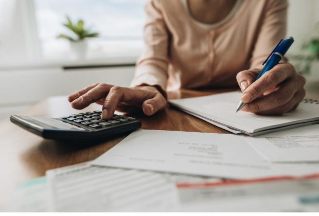 Comment calculer le rapport d'assujettissement de la taxe sur les salaires en présence de secteurs d'activité distincts?